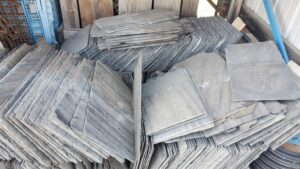 Reclaimed slate roofing tiles packed in crate