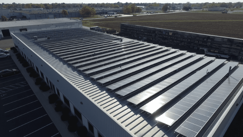 Aerial view of solar panels on the Cornett Roofing building