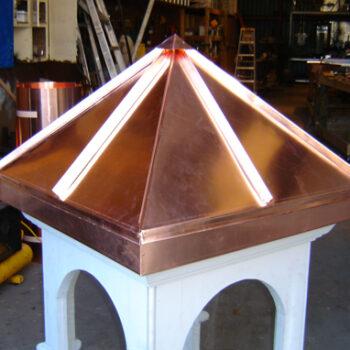 Decorative copper cap for roof spire