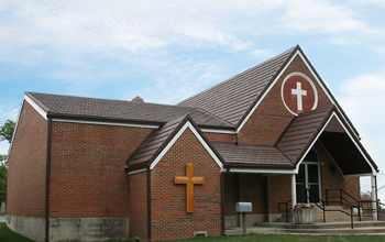 Church with Metal Shake Series roof installed with blue sky