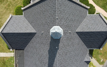 Aerial view of church spire and Metal Shake roof installed