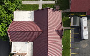 Aerial view of church with Metal Tile Series installed in red