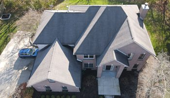 aerial view of shingle roof home