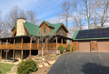 log cabin with green metal roof