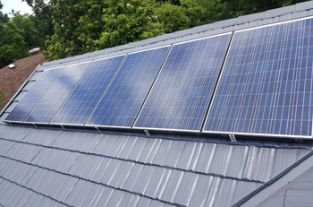 metal roof with solar panels installed