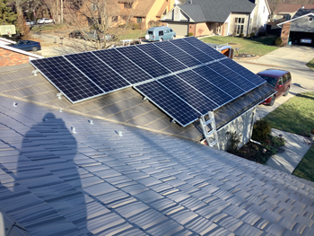 gray metal roof with solar panels