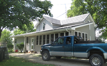 truck and house with shiny metal roof