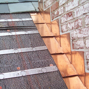 copper step flashing on roof