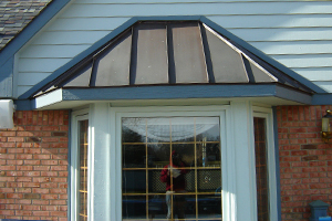 steel bay window cover on home