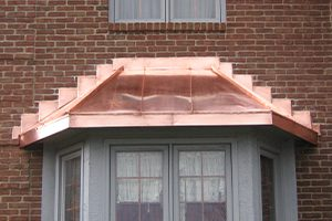 copper bay window cover on home