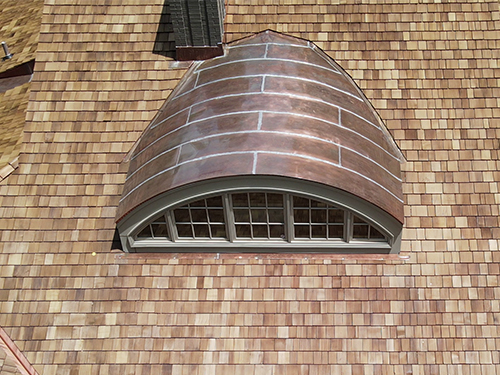 copper dome on wood shake roof