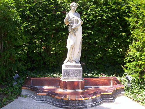 statue with a copper fountain base