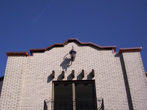 copper trim on front of church