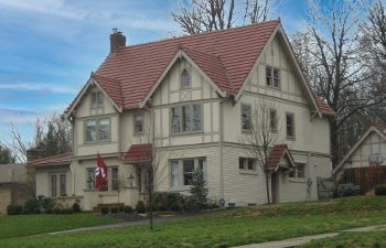 large home with clay tile roof