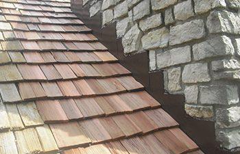 wood shake roof with flashing on chimney