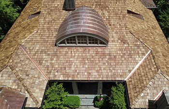 wood shake roof and copper dome